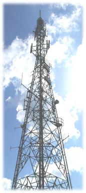 Typical multi-service Cellular, PMR, Point to Point microwave telecommunications transmission and base station mast.